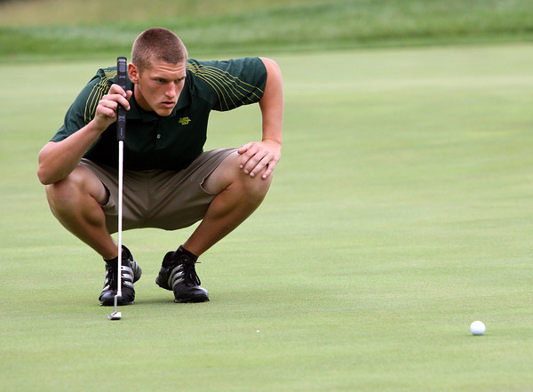 Floyd Central golfer Daniel Shepard studies his putt on the eighth green of the IHSAA Golf Sectional on Monday at Covered Bridge Golf Club. Staff photo by C.E. Branham