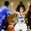 Providence Juston Betz covers Indianapolis Metropolitan guard De'Andre Huskie during their game at Providence on Friday. Staff photo by Christopher Fryer