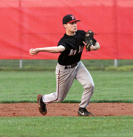 New Albany second baseman Tucker Marcum makes a play for an out against Jeffersonville Wednesday night. Staff photo by C.E. Branham