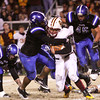 Charlestown defender Darren Taylor wraps up Gibson Southern quarterback Jordan Scheller for a turnover on downs in the first half. Staff photo by C.E. Branham