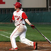 Jeffersonville hitter Trent Astle rips a double to score a run against New Albany Wednesday night. Staff photo by C.E. Branham