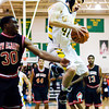 Floyd Central forward Conner Sturgeon comes down with a rebound during the Highlanders' home game against New Albany on Friday. New Albany won the game 49-45. Staff photo by Christopher Fryer