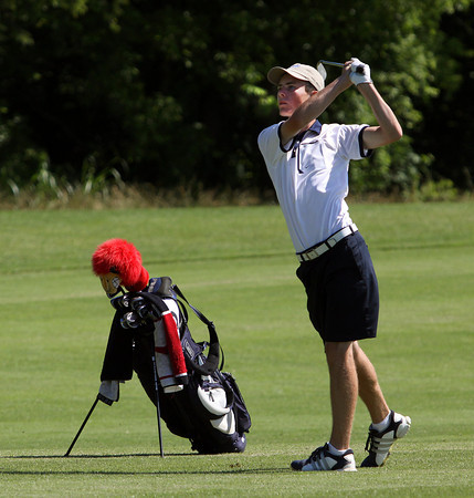 Providence golfer Cory Chalan hits an approach to the 13th green while playing in the IHSAA Golf Regional on Thursday. Staff photo by C.E. Branham