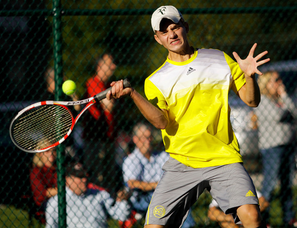 Floyd Central senior Ryan Plunkett moves to return a shot to New Albany freshman Logan Charvonneau during their No. 1 singles match in the regional tournament at Floyd Central on Tuesday. Staff photo by Christopher Fryer