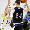 Floyd Central forward Colton Kimm guards Providence center George Knott during their game at Floyd Central on Saturday. Providence won the game, 43-31. Staff photo by Christopher Fryer