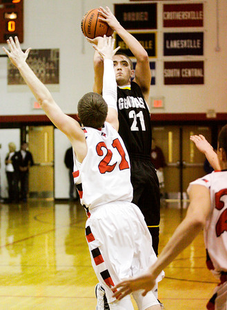 Clarksville's Aidan McEwen goes up for a shot during their game at Borden on Friday. Staff photo by Christopher Fryer