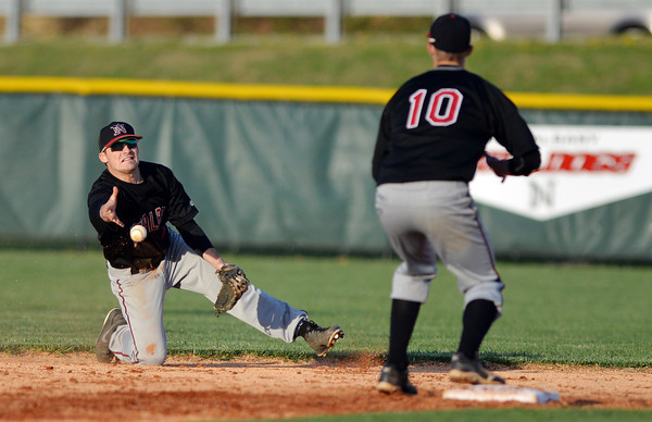 New Albany second baseman Tucker Marcum gets the force out at second after diving for a grounder up the middle during Floyd Centrals' 12-4 victory over the Bulldogs Wednesday evening.<br /> Staff photo by Tyler Stewart