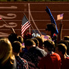 The Jeffersonville High School student section waves American flags during the national anthem before their season opener against Louisville Eastern High School on Friday evening. Staff photo by Christopher Fryer