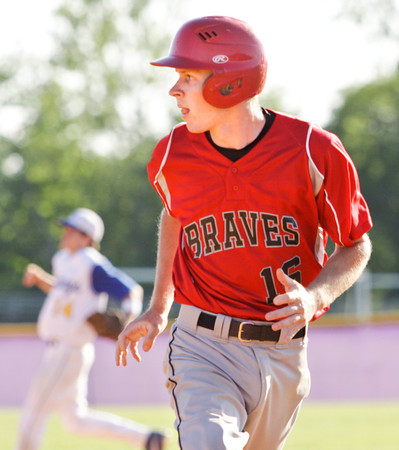 Borden senior Jared Sanders approaches third on a David Vansant single during their game against New Washington in the Lanesville sectional tournament on Friday. Staff photo by Christopher Fryer