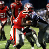 Jeffersonville running back Austin Hines carries in a 13-yard touchdown for the Red Devils Friday night against New Albany. Staff photo by C.E. Branham