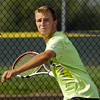 Floyd Central senior Justin Batliner prepares to return the ball to Jeffersonville senior Jordy Rigsby during their No. 1 singles match at Jeffersonville on Wednesday. Staff photo by Christopher Fryer