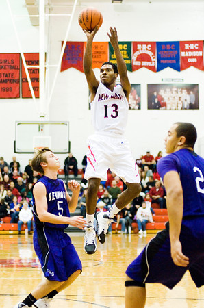 New Albany guard Leondre McBirth goes up for a shot during the Bulldogs' home game against Seymour on Friday. Staff photo by Christopher Fryer