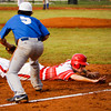 Jeffersonville senior Josh Burke slides safely into third base during the Red Devils' 4-0 win over Jennings County at the New Albany Sectional on Wednesday. Staff photo by Christopher Fryer