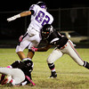 New Albany junior Jeffontae McClain hits Seymour senior Gabe Jordan during the first half of their game at New Albany on Friday. New Albany lost the game, 22-20. Staff photo by Christopher Fryer