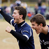 Providence defenders Cody Schrank, left, and Tommy Davis celebrate after defeating Evansville Mater Dei 3-2 in overtime during the second semifinal of the Class A Floyd Central Semistate on Saturday. Staff photo by Christopher Fryer