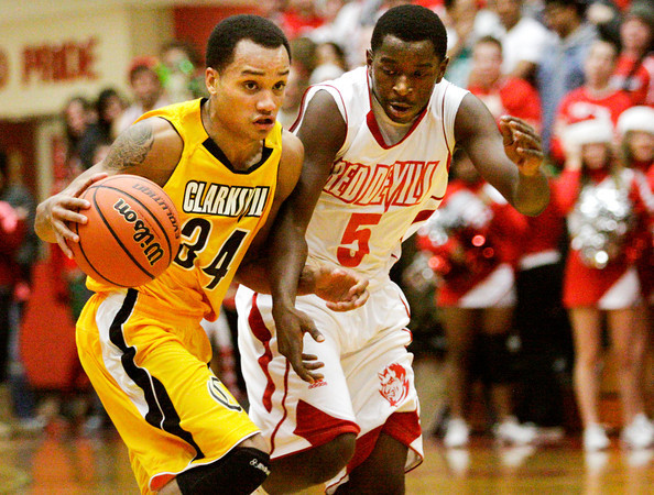 Clarksville guard Andrew Jones moves the ball down court past Jeffersonville's Jacquari Chandler during their game at Jeffersonville on Friday. Jeffersonville won the game, 77-59. Staff photo by Christopher Fryer