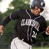 Clarksville senior Nathaniel Jones rounds third base on his way to score on an inside-the-park home run during their game against Henryville in the first round of the Providence sectional tournament on Wednesday. Staff photo by Christopher Fryer
