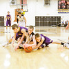 Henryville guard Braxton Robertson fights for a loose ball with Eastern forwards Dalton Jackson, left, and Dakota Snider during their game at Henryville on Thursday. Staff photo by Christopher Fryer