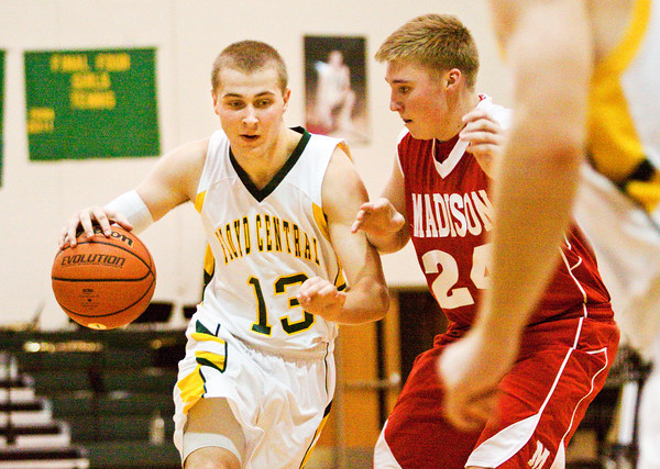 Floyd Central forward Colton Kimm drives the ball down court during their home game against Madison on Saturday. Madison won the game, 63-41. Staff photo by Christopher Fryer
