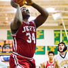 Jeffersonville senior Dionte Allen goes up for a shot during the Red Devils' game at Floyd Central on Friday. Floyd Central won the game, 71-70. Staff photo by Christopher Fryer