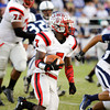 Jeffersonville running back Austin Hines moves the ball downfield during their game at Providence on Friday. Staff photo by Christopher Fryer