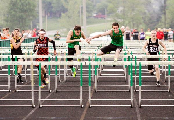 Runners compete in the 110-meter hurdles during the Floyd Central sectional track meet on Thursday. Staff photo by Christopher Fryer