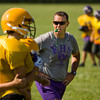 Eastern head coach John Dablow runs drills with his team during practice in New Pekin on Wednesday morning. Staff photo by Christopher Fryer