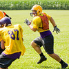 Eastern senior Brian Arnold closes in on the ball during practice in New Pekin on Wednesday morning. Staff photo by Christopher Fryer