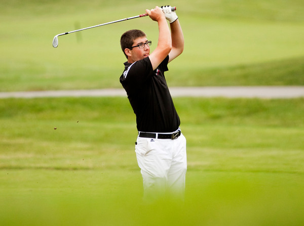 New Albany's Addison Greenwell hits from the fairway on the 15th hole during the Providence Sectional at Covered Bridge Golf Club on Monday. Staff photo by Christopher Fryer