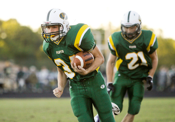 Floyd Central running back Gaige Klingsmith moves the ball downfield on a touchdown run during their home game against Seymour on Friday. Staff photo by Christopher Fryer