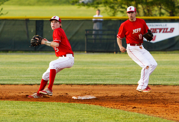 Jeffersonville's Josh Burke turns to throw to first base for a double play during the Red Devils' 7-6 victory at Floyd Central on Monday. Staff photo by Christopher Fryer