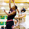 New Albany center Nick White goes up for a shot during the Bulldogs' game at Floyd Central on Friday. New Albany won the game 49-45. Staff photo by Christopher Fryer