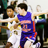 Floyd Central guard Myles Ervin moves the ball downcourt during the Highlanders' home game against Jennings County on Tuesday. Staff photo by Christopher Fryer