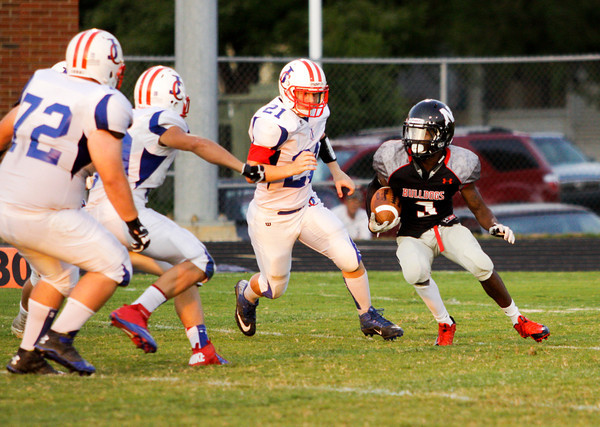 New Albany running back Tuwan Payton attempts to avoid Jennings County defenders during their game in New Albany on Friday. Staff photo by Christopher Fryer