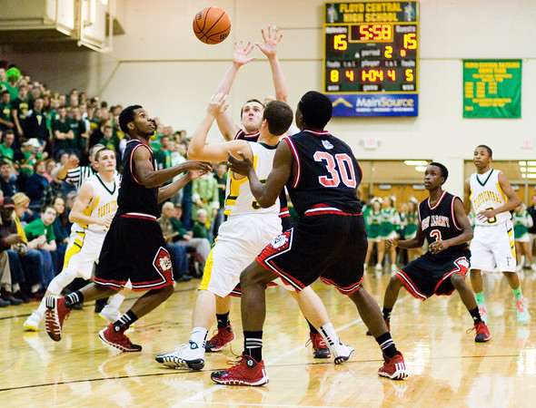 New Albany and Floyd Central players fight for control of a loose ball during their game at Floyd Central on Friday. New Albany won the game 49-45. Staff photo by Christopher Fryer