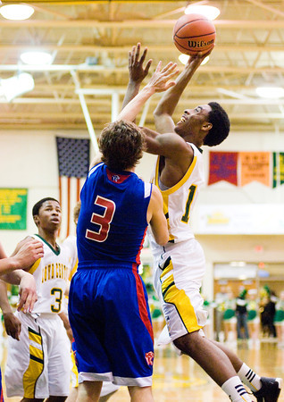 Floyd Central forward Mike Lewis is fouled while going up for a shot during the Highlanders' home game against Jennings County on Tuesday. Staff photo by Christopher Fryer
