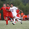 New Albany senior Ramiro Zarate passes the ball across the field during their home game against Jeffersonville on Tuesday. Jeffersonville won the game, 2-1. Staff photo by Christopher Fryer