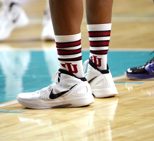 Indiana All-Star and Indiana University recruit Ron Patterson wore a pair of IU socks in the game against the Kentucky All-Stars Friday night at Freedom Hall. Staff photo by C.E. Branham