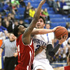 Charlestown senior Aaron Daniel drives to the hoop on Jeff defender Kortrell White Tuesday night. Staff photo by C.E. Branham