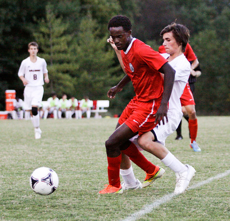 Jeffersonville senior Leonard Kwitonda and New Albany sophomore Cameron Gentry fight for possession of the ball during their game at New Albany on Tuesday. Jeffersonville won the game, 2-1. Staff photo by Christopher Fryer