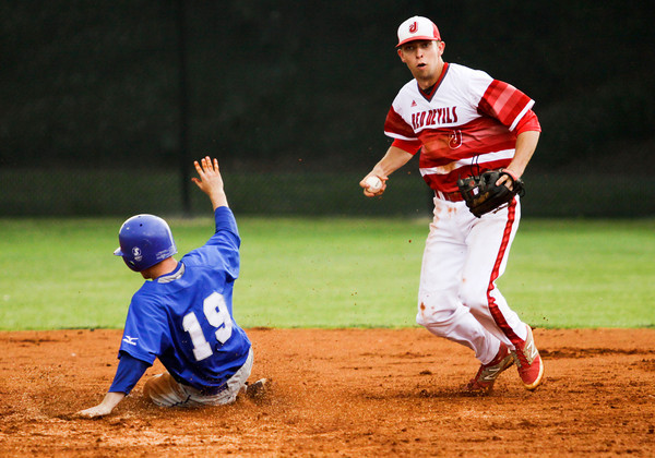 Jeffersonville senior Drew Ellis moves to attempt a double play after forcing an out at second base during the Red Devils' 4-0 win over Jennings County at the New Albany Sectional on Wednesday. Staff photo by Christopher Fryer