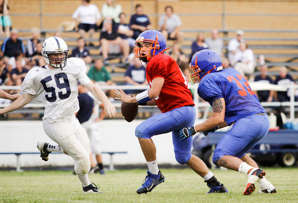 Silver Creek quarterback Jake Meadors looks to pass during their scrimmage at Providence on Friday. Staff photo by Christopher Fryer