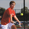 Jeffersonville No. 2 singles player Austin Hunt returns volley to New Washington player Logan Miles in the Jeffersonville Tennis Sectional final Thursday afternoon. Staff photo by C.E. Branham