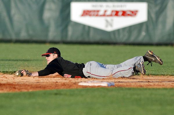 New Albany second baseman Tucker Marcum dives for a ground ball up the middle during Floyd Centrals' 12-4 victory over the Bulldogs Wednesday evening.<br /> Staff photo by Tyler Stewart