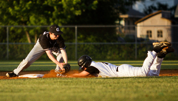 Henryville senior Dakota Harrell is tagged out at second base by Clarksville freshman Cody Leonhardt during their game in the first round of the Providence sectional tournament on Wednesday. Staff photo by Christopher Fryer