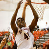 New Albany center Anthony Edwards goes up for a rebound during their home game against Corydon Central on Saturday. New Albany won the game, 63-48. Staff photo by Christopher Fryer