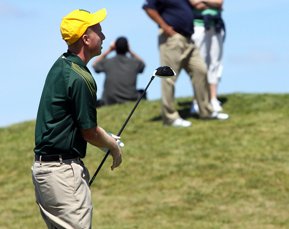 Floyd Central golfer Austin Peckham track his drive off the 17th tee Wednesday in the IHSAA State Golf Finals. The Highlander senior shot a 73 to help his team to a fifth place finish. Staff photo by C.E. Branham