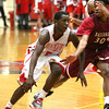Jeffersonville senior Jaquari Chandler drives on Ballard defender Lavone Holland. Staff photo by C.E. Branham