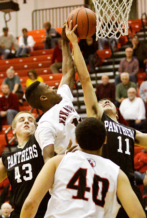 New Albany forward Javen Reeves goes up for a shot during their home game against Corydon Central on Saturday. New Albany won the game, 63-48. Staff photo by Christopher Fryer