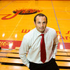 Jeffersonville's new head boys' basketball coach stands in William S. Johnson Arena at Jeffersonville High School on Thursday. Staff photo by Christopher Fryer